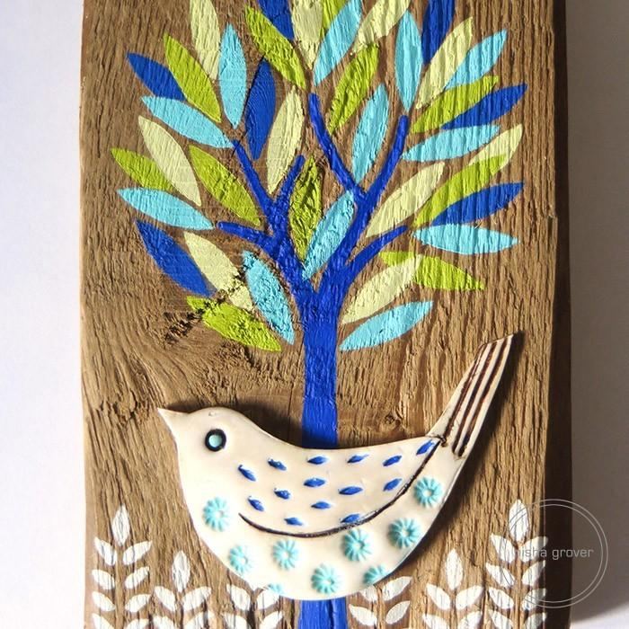 Bird in tree on wood