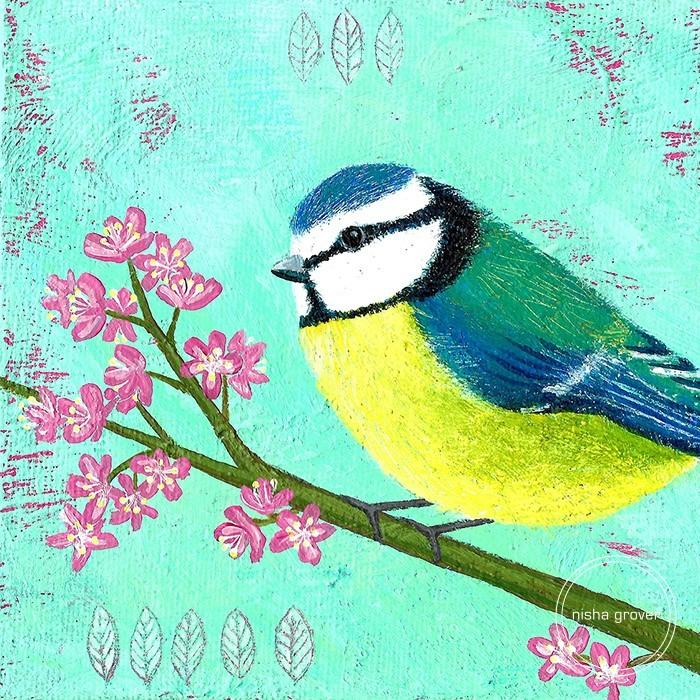 Blue tit with blossom